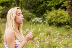 Young woman posing with flowers . Outdoor shot. Stock Photos
