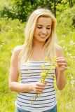 Young woman posing with flowers . Outdoor shot. Stock Photo