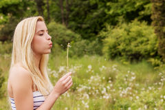 Young woman posing with flowers . Outdoor shot. Royalty Free Stock Images