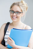Young woman posing with folders Stock Photography