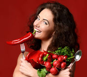 Young woman posing with fresh red vegetables radish pepper green Stock Photography