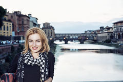 Young woman posing in front of amazing bridge Ponte Vecchio, Flo Stock Photos