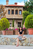 Young woman posing in front of a beautiful house Stock Photo