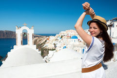 Young woman posing in front of bell tower, Santorini Stock Photo