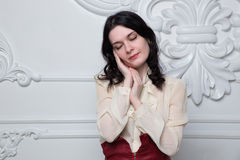 Young woman posing gesturing sleeping in studio Royalty Free Stock Image