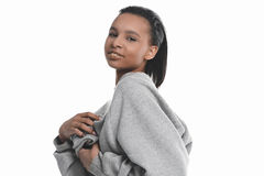 Young woman posing in grey sweater and smiling at camera. Attractive young woman posing in grey sweater and smiling at camera Royalty Free Stock Images