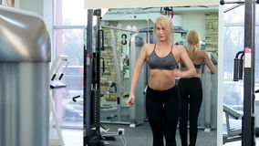 Young woman posing in a gym stock video