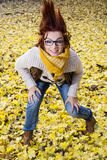 Young woman posing with hair in autumn leaves Stock Image
