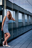 Young woman posing inside a modern building Stock Photo