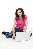 Young woman posing with laptop Stock Image