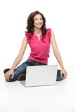 Young woman posing with laptop Stock Images