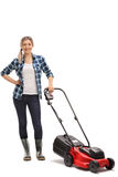 Young woman posing with a lawn mower Stock Images