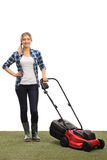 Young woman posing with a lawnmower Royalty Free Stock Photography