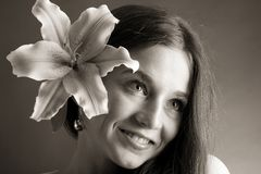 Young woman posing with a lily Royalty Free Stock Image