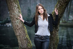 Young woman posing with lips thrown out. At the lake Stock Images