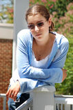 Young Woman Posing. Young model posing in natural casual setting on location outdoors Royalty Free Stock Images