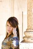 Young woman posing near antique column Stock Photos