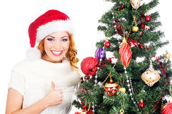 A young woman posing near the Christmas tree Stock Photo