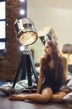 Young woman posing near the mirror Stock Photos