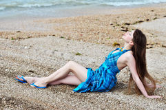 Young woman posing near the sea Royalty Free Stock Photography