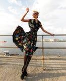 Young woman posing near the sea. Stock Photos