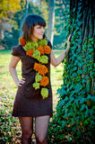 Young woman posing outdoor dressed in handmade dress. Stock Photos