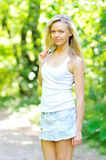 Young woman posing outdoors. Romantic young woman posing outdoors stock photography