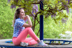 Young woman posing outdoors Royalty Free Stock Photos