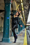 Young woman posing outside in NYC subway station. Royalty Free Stock Photo