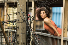 Young  woman posing on overpass among the electric wires. Royalty Free Stock Photography