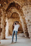 Young woman posing in Park Guell in Barcelona Stock Images