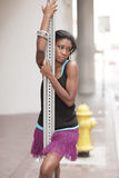 Young woman posing on a pole Royalty Free Stock Image