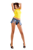 Young woman posing in ragged shorts Royalty Free Stock Photography