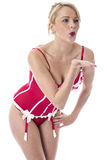 Young Woman Posing in Red Lingerie Blowing Kisses Royalty Free Stock Images