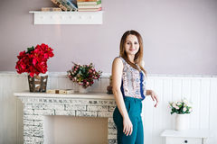Young woman posing in the room stock photography