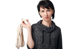 Young woman posing with rope and soap in studio on white background, wearing brown shorts and shirt Royalty Free Stock Photography
