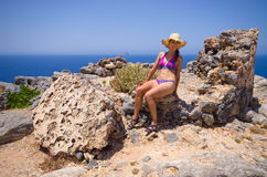 Young woman posing in ruins on Gramvousa island, Crete, Greece Stock Photography