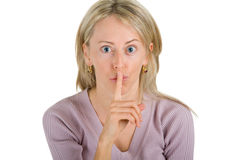 Young woman posing a silence gesture Royalty Free Stock Image
