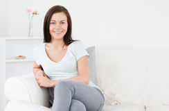 Young woman posing on the sofa Stock Photography