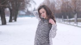 Young woman posing in stylish clothes outside in the winter stock footage