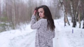 Young woman posing in stylish clothes outside in the winter stock video