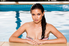 Young Woman Posing in a Swimming Pool Royalty Free Stock Photography