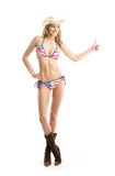 A young woman posing in a swimsuit and a hat Royalty Free Stock Image