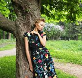 Young woman posing on a tree Stock Photo