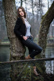 Young woman posing at the tree Stock Photography
