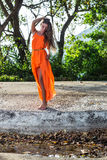 Young woman posing in the tropical park Stock Photo