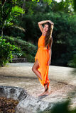 Young woman posing in the tropical park Royalty Free Stock Photo