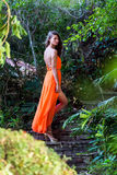 Young woman posing in the tropical park Royalty Free Stock Images