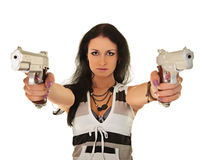 Young woman posing with two pistols Royalty Free Stock Image