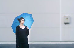 Young woman posing with umbrella. Young woman posing with blue umbrella Royalty Free Stock Images